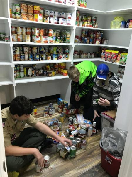 Boy Scouts volunteering time for Food Pantry